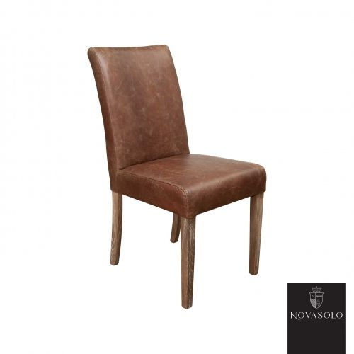 """Lekker og stilren Old Amsterdam spisestol i """"vintage leather"""" med et flott og spennende design på stolryggen."""