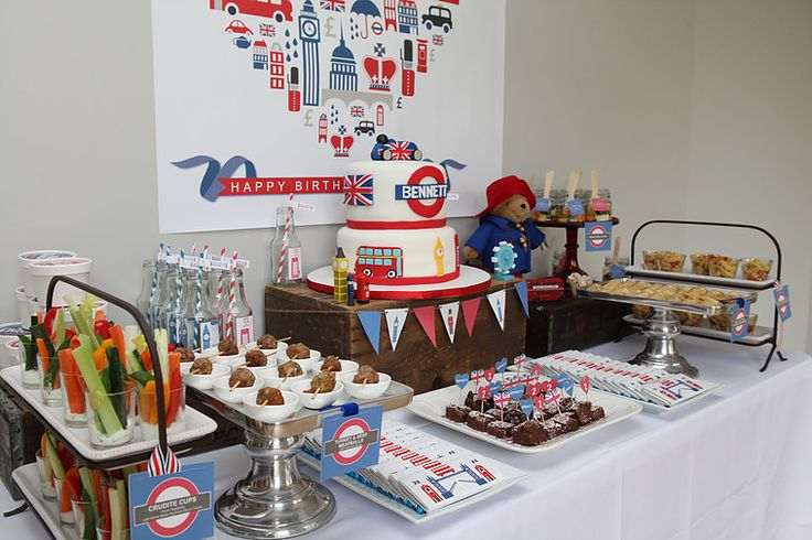 Union Jack themed decorative food table #unionjackpartydecorartion #unionjackpartydecor #unionjackthemedparty #londontownpartydecor #unionjackpartyideas