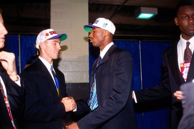 Kobe Bryant who was drafted number thirteen overall by the Charlotte Hornets and Steve Nash, drafted number fifteen  by the Phoenix Suns greet each other during the 1996 NBA Draft on June 26, 1996