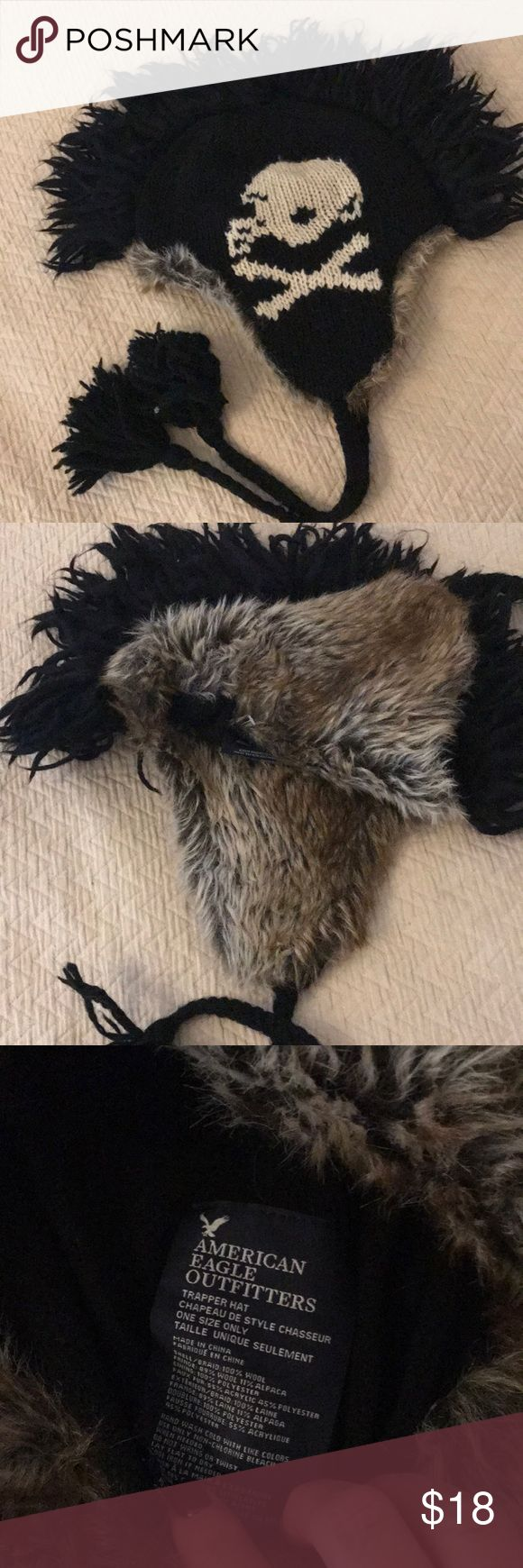 AMERICAN EAGLE OUTFITTERS trapper hat American eagle outfitter trapper hat. Faux fur interior, wool exterior black with football logo and Mohawk style. Tassel ties. Very warm and covers ears. Make an offer! American Eagle Outfitters Accessories Hats