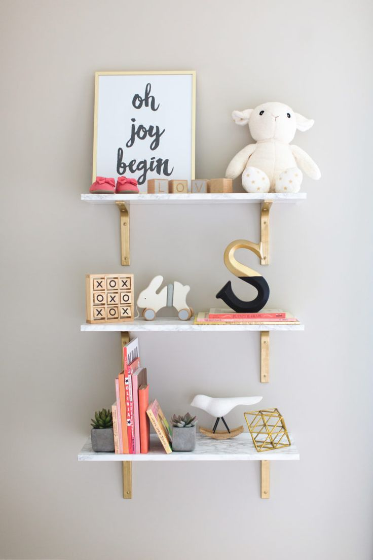 Gold and White Nursery Shelves