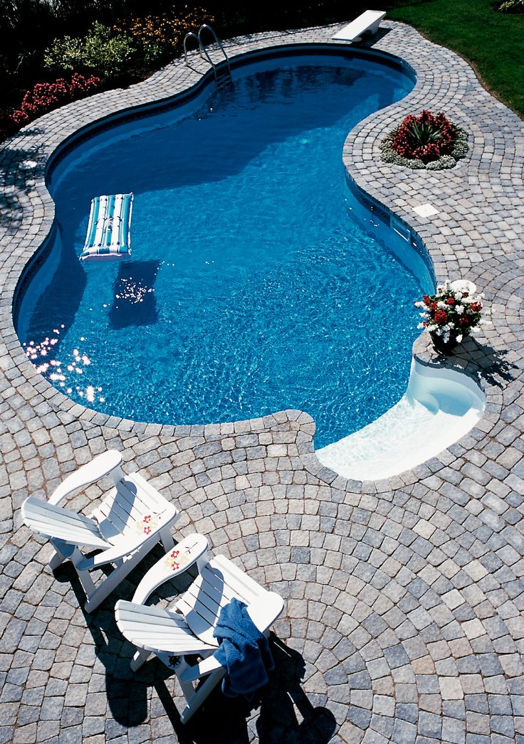 Cool Stone Pool Deck Design Ideas With Twin White Chair On Stone Pool Deck  In Simple Shape Swimming Pool (Cool Pools Small)