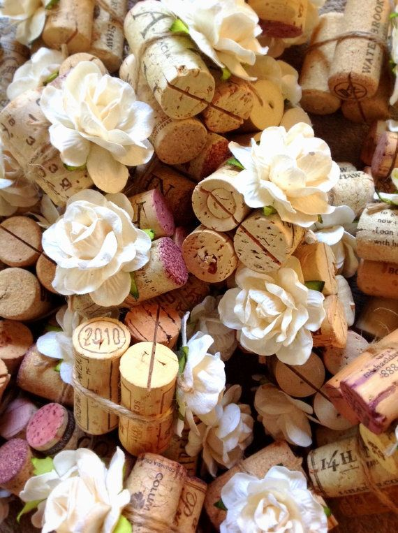 Rustic wedding theme place card holders, made from vintage wine corks and handmade flower blooms #rustic #fall #wedding