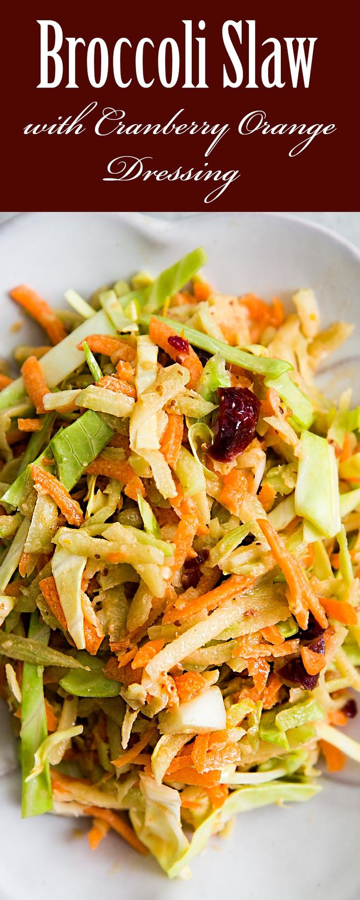 Broccoli Slaw with Cranberry Orange Dressing ~ Broccoli slaw, a coleslaw made with broccoli stems, cabbage, and carrots, with a tangy cranberry orange dressing. ~ SimplyRecipes.com