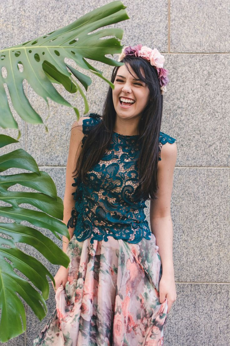 Emerald green lace top with Floral printed chiffon skirt. Credits: Model: Dominique Mabille. Photographer: Tina Hsu. Location: Greenmarket Square, Cape Town, South Africa