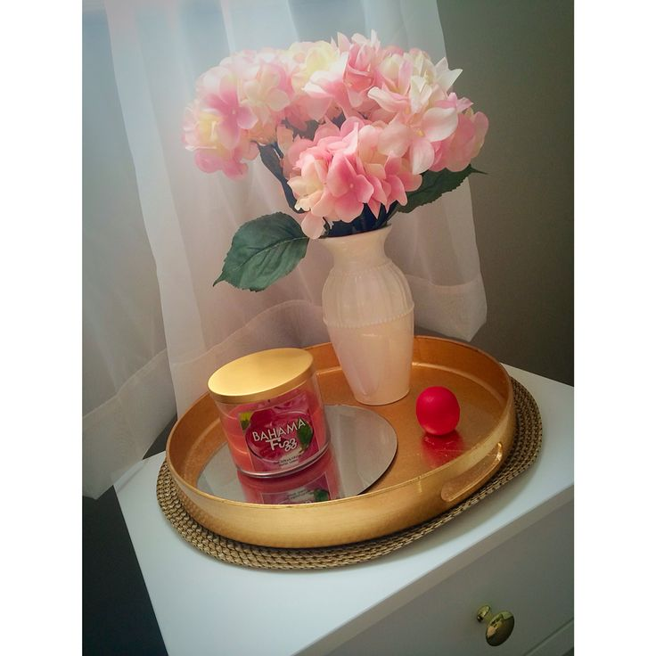 White and gold bed side table from Ikea. Flowers from Michaels. Bath &  Body Works candle. Gold tray from Target.