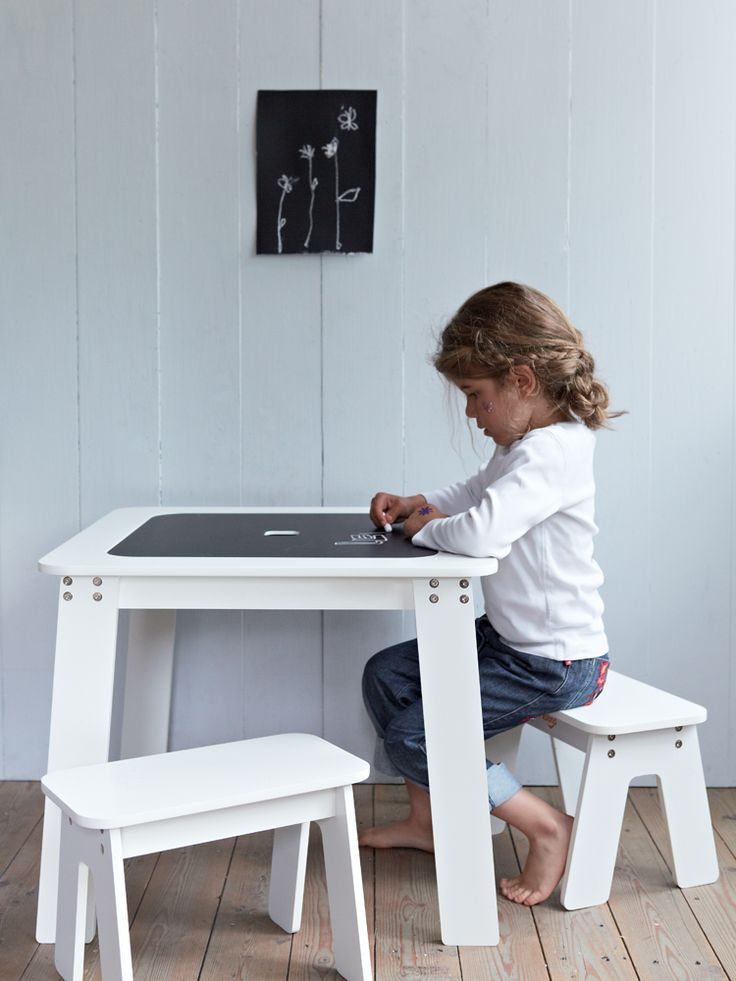 I've been looking for this exact table for ages. The perfect children's table: Reversible Chalk Table from Cox & Cox
