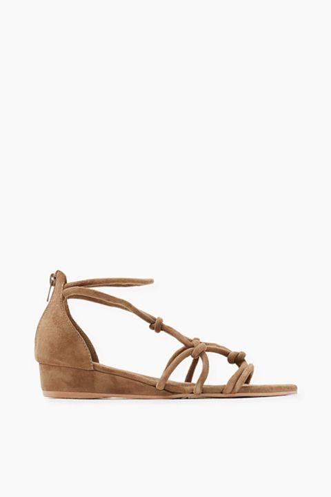 Sandales compensées en cuir 60€