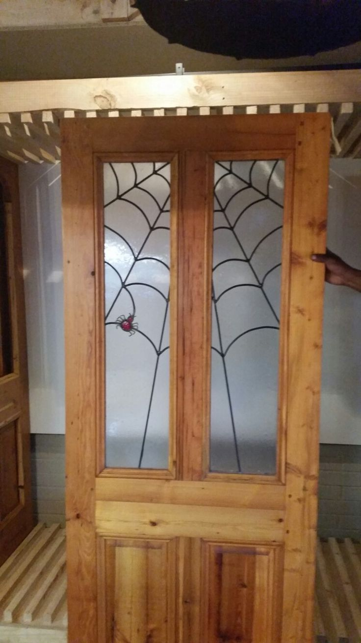 Spider Web front door.  New - made from recycled timber