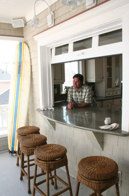 kitchen window opens to a patio bar. How cool!?
