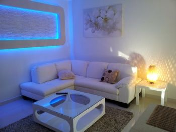 This apartment in Rockdale has completely been wired with led lighting including the feature wall.