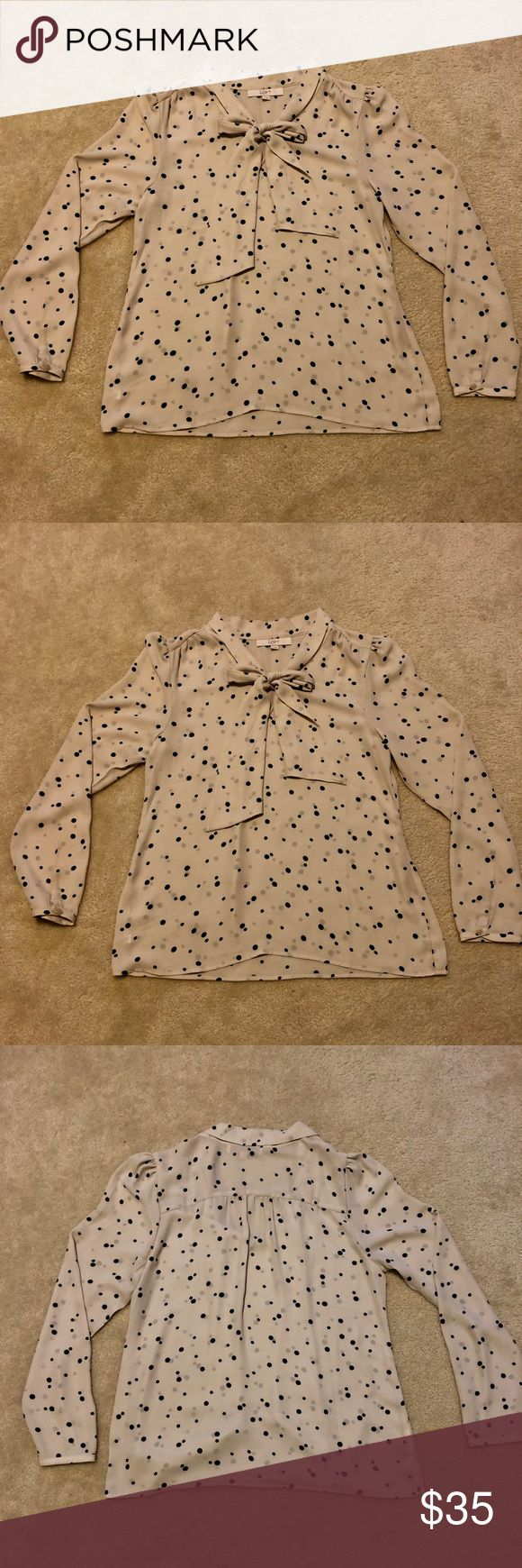 Loft Cream Polka Dot Tie Blouse- Size Medium Beautiful and Classy Loft Cream Tie Blouse with Black Polka Dot Detail- Size Medium. Light material that can be dressed up for work or paired with skinny jeans and heels for a night out! Great condition! LOFT Tops Blouses