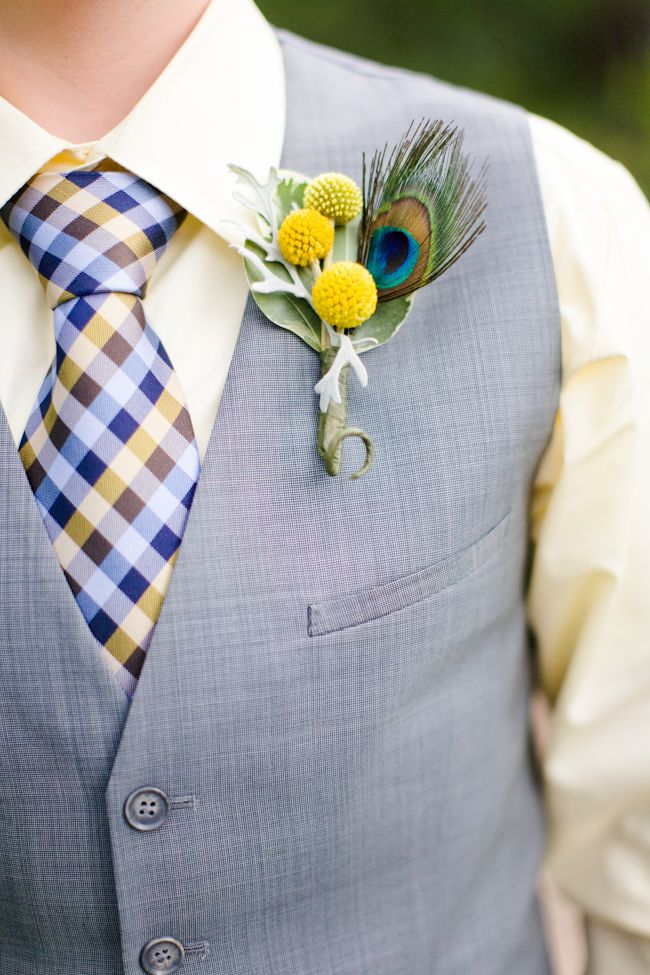 peacock feather boutonniere.
