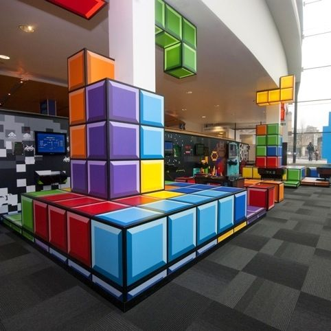 Games Lounge - National Media Museum in Bradford. Tetris style decor, awesome retro interior design.