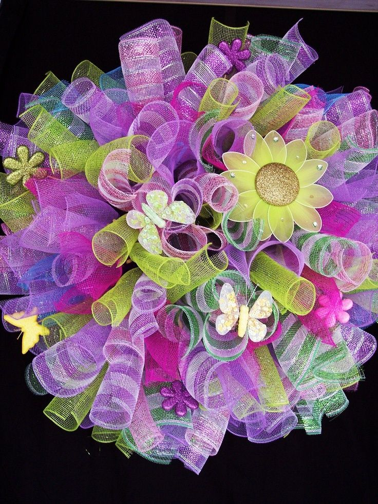 """Spring Easter Spiral Deco Mesh Wreath.    Used this as a """"blue print"""" to go off of to create the beautiful wreath I   created as the centerpiece of my front door decor at Primeaux Photography   Studio"""