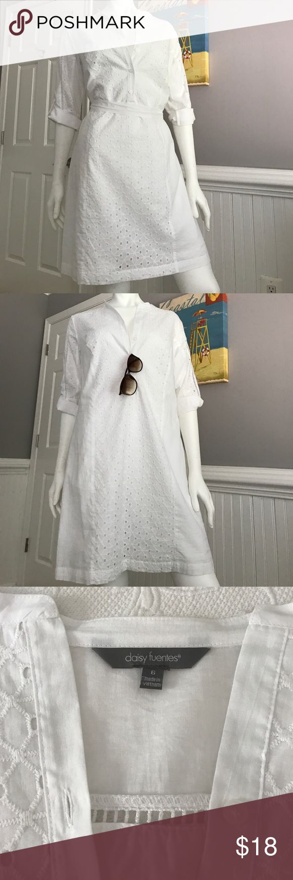 Chic Beach Dress/ Resort Wear Perfect Resort wear! Chic Beach cover up @ daytime , then throw on a belt and cute flat & voila! - perfect for dinner or drinks! Crisp white with lovely crochet/ eyelet detail. New- never worn & immaculate. Size 6. Comes with a white cloth belt ( brown belt not included) L 35 pit 2 pit 22 Daisy Fuentes Dresses