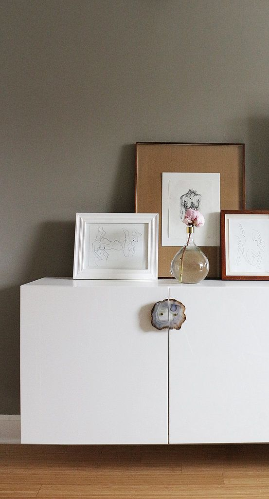 An ingenious DIY transforms these Ikea Besta units into beautiful and expensive-looking storage; Victoria simply swapped the Ikea handles for gorgeous agate knobs!