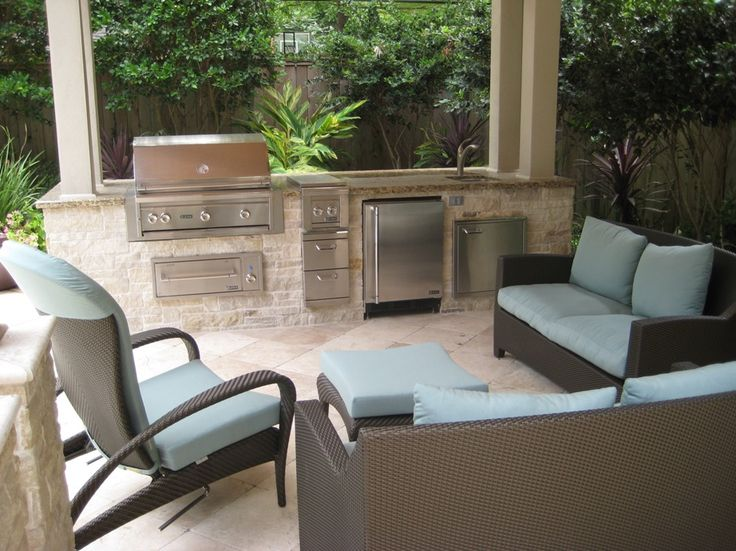 Limestone Outdoor Kitchen With Nice Patio Furniture, Grill, Warming Drawer,  Refrigerator, And