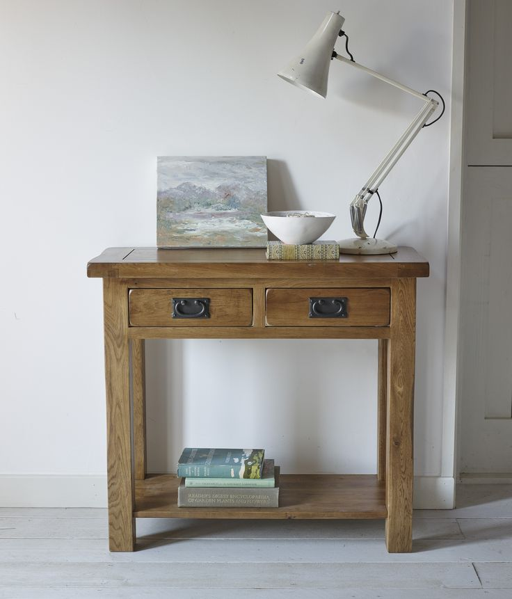 The Original Rustic Solid Oak 2 Drawer Console Table is handcrafted from the finest cuts of solid oak throughout and features a traditional styling. Designed to be placed against the wall, it's ideal as a piece of hallway furniture but would be equally at home in the living room to hold a lamp and photo frames.