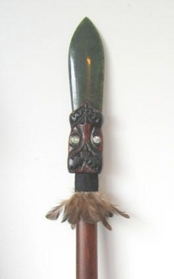 Before the Europeans set foot in New Zealand warfare between Maori tribes was commonplace. From a young age male members of Maori tribes were educated in warfare and combat tactics.   Later on the British colonial troops would find out how fierce and powerful these experts in guerilla warfare were. Typical Maori weapons are the maripu, patu and taiaha.   On the photo a taiaha with greenstone jade spear point resembling the ever reoccurring tongue. This taiaha has a wood carving on the base.