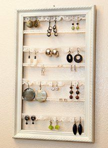 Lacy Vintage Earring Organizer made form a picture frame. awesome!