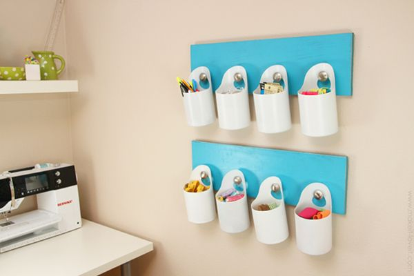 Cut, affix and use old detergent, soap and bleach bottles for nifty and good looking storage..