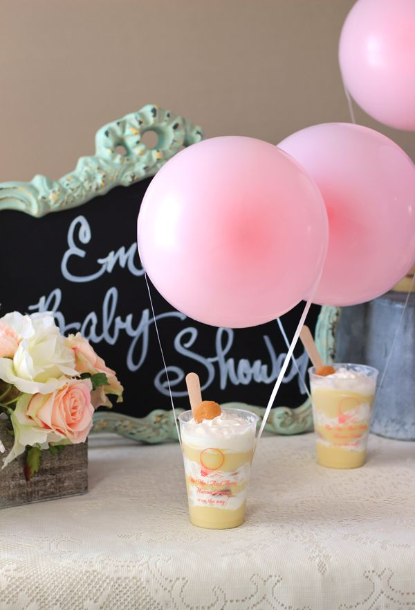 How cute is this? Adorably designed for an Up Up and Away girl baby shower party theme, these personalized frosted plastic cups are reusable and dishwasher-safe for a custom souvenir take-home idea for guests. Available in a variety of size options, personalize your cups below the hot air balloon design shown. Fill your cups with a dessert and attach helium filled balloons to recreate the look shown. You can order at http://www.tippytoad.com/up-up-and-away-personalized-plastic-cups.asp