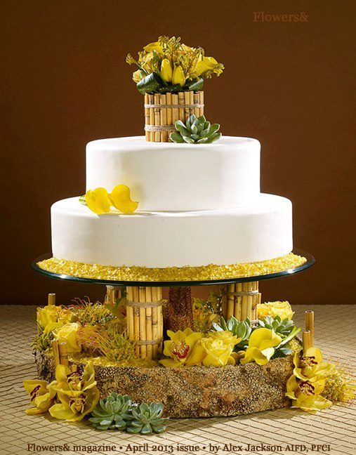 Very #unique #yellow #wedding #cake. Like it or not? #weddings #realweddings #events #realevents #eventplanning #bride #weddingideas #unique #uniqueweddingideas #yellowweddings #flowers #yellowweddingideas #weddingcake #dessert