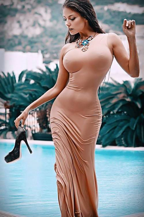 Awesomeness.......That tall beauty needs to go back into the pool and really WET that clinging dress on her in the summer sun.