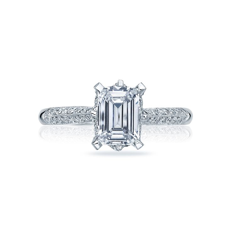 Flaunt+sophisticated+style+with+this+platinum+engagement+ring.+Two+rows+of+round+diamonds+decorate+the+ceiling+of+the+ring,+with+bold+flattened+platinum+prongs+securing+the+emerald+cut+(pictured)+into+place.