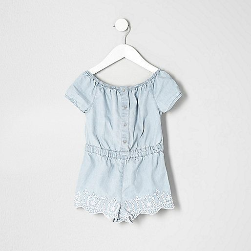 Woven fabric Embroidered and scalloped hem detail Elasticated waist Buttoned front Scoop neck Short sleeve