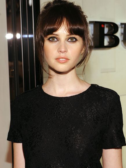 Loving the parted bangs look right now...