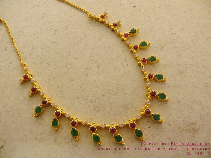 Mehta Jewellery Studded with Emerald, Rubies and Zircon stones this Delicate necklace is sure to bring lots of compliments your way!