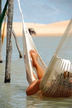 Cool off in the ocean with a hammock hung low to take advantage of calm waters.