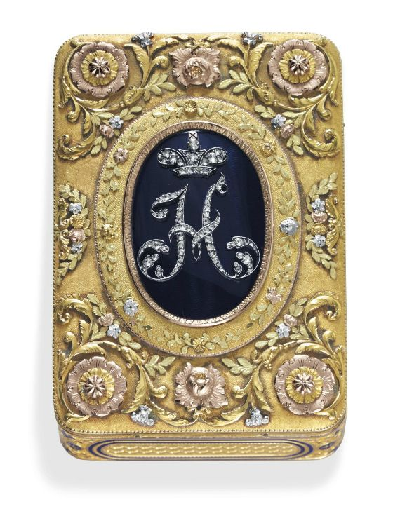 A GERMAN VARI-COLORED GOLD, ENAMEL AND GEM-SET SNUFFBOX MARK OF CHARLES COLINS SÖHNE, HANAU, CIRCA 1830 The base and sides with engine-turned panels within blue enamel borders, the cover finely chased with flowerheads and scrolling foliage in four colors centering diamond-set initial beneath a royal crown against a blue guilloché enamel oval, marked inside base