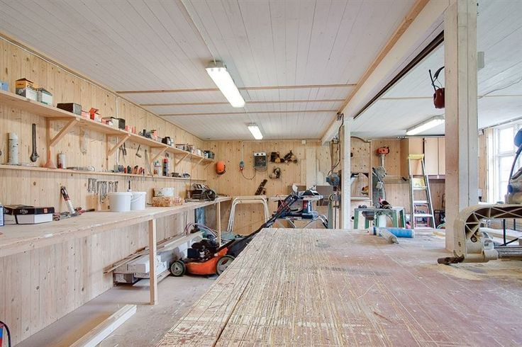 workshop with white ceilngs and side windows with bright, arctic light