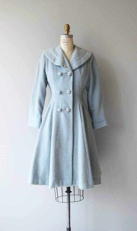 Vintage 1950s pale cloud blue wool princess coat with double breasted buttons, wide rounded collar, fit and flare shape, full skirt, hip pockets and pale blue silk lining. --- M E A S U R E M E N T S --- fits like: xs/small/medium shoulder: 14.5 bust: 32-34 waist: up to 29 hip: free sleeve: 21.5 length: 39 brand/maker: n/a condition: excellent ★ layaway is available for this item ➸ More vintage coats http://www.etsy.com/shop/DearGolden?section_id&#x3...