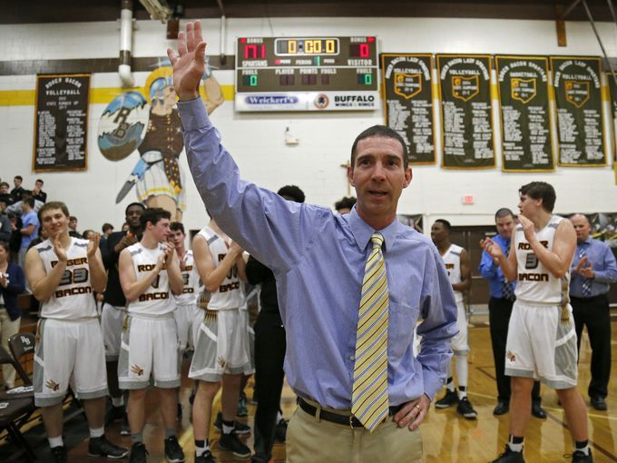 Brian Neal becomes winningest Roger Bacon coach vs. Fenwick. Photo: Roger Bacon head coach Brian Neal thanks the crowd as he's honored after the OHSAA high school boys' basketball game between the Roger Bacon Spartans and the Fenwick Falcons at Roger Bacon High School in St. Bernard, Ohio, on Tuesday, Jan. 26, 2016. Coach Neal became the winningest coach in school history with a 69-28 win at home. The Enquirer/Sam Greene