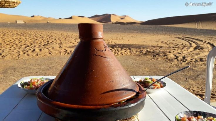 Q: How would you like your tajine?  A: With a magical view...  http://www.morocco-objectif.com/  #moroccoobjectif #tajin #tajine #food #sanddunes #sahara #desert #merzouga #nomad #berber #amazigh #instafood #delicious #traditional #almaghreb #africa #travel #travelphotography #instatravel #wander #traveler #life #morocco #maroc #marruecos #marokkos #marrocos  Tours around Morocco  Private desert tours from Fes