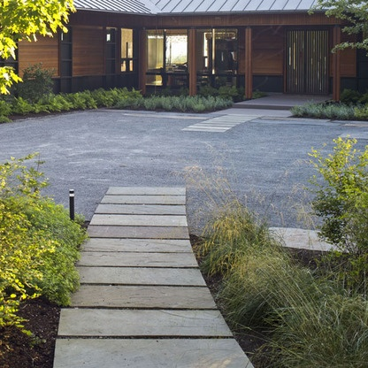 transition of stone pavers inlaid into crushed stone, in an entrance court by Keith Wagner Landscape Architects, Shelburne, Vermont