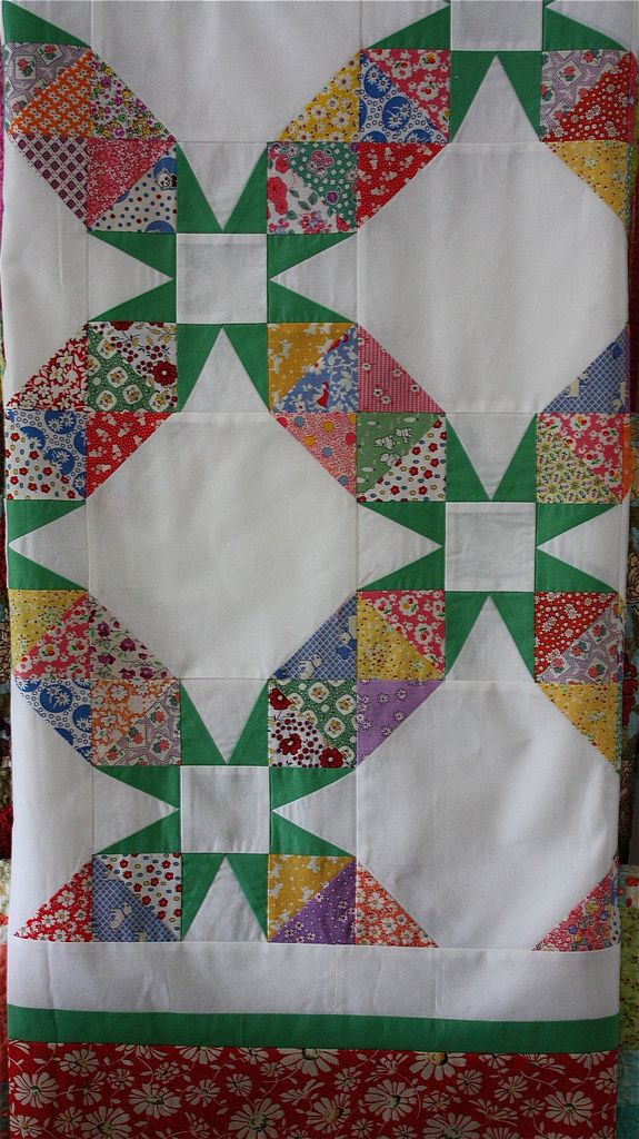Illusions of a wedding ring quilt. It's actually a Tennessee Waltz with half square triangles instead of 4 patches. Uses the traditional 54-40 block.