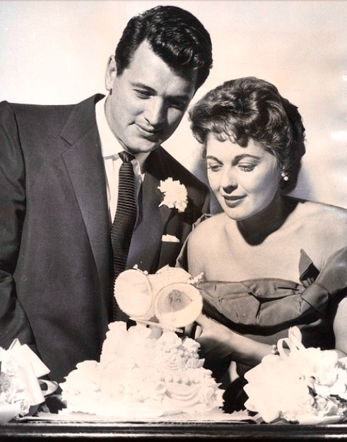 Rock Hudson and his wife Phillis Gates  She married him to help keep his cover as well as her own.