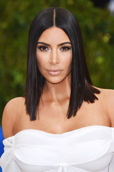 Kim Kardashian's pin straight lob looked shiny and sleek on the Met Gala red carpet.