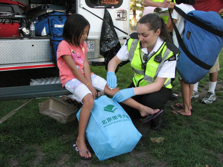 Brigade member caring for patient at the Celebration of Light in Vancouver.