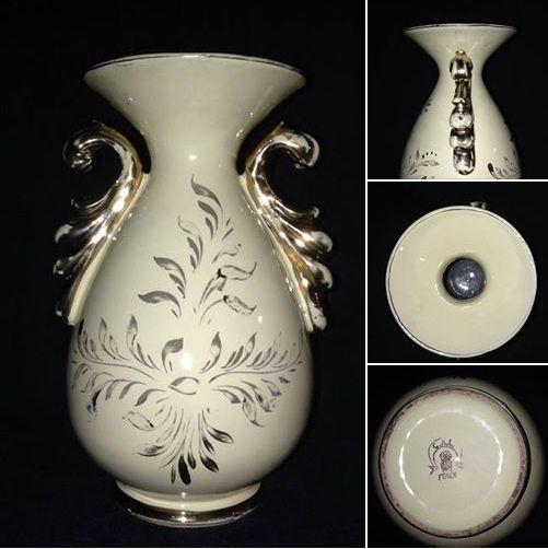 """CERAMICA LODIGIANA. Grazioso vaso in ceramica """"C.A.L."""". La fabbrica realizza una produzione dai decori all'italiana e alla francese che si distinguono per la policromia vivacissima, il disegno eclettico. Il vaso alto 20,5 centimetri e largo 13 centimetri ha una base giallo chiaro e i decori in oro a terzo fuoco. La ceramica non presenta sbeccature ma, il decoro in oro qua e là è evanescente. Tale carenza non ne deprezza il valore artistico e, vieppiù, la bellezza intrinseca."""