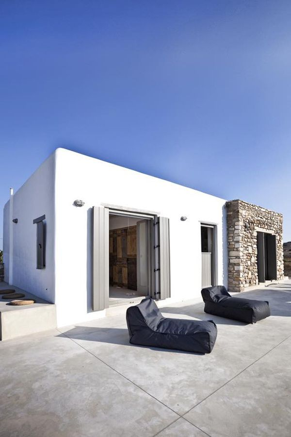 This villa on the Greek island of Antiparos is a former stone ruin that has been converted into a stylish two bedroom summer home. It is surrounded by two acres of land which gives a lot of privacy. T