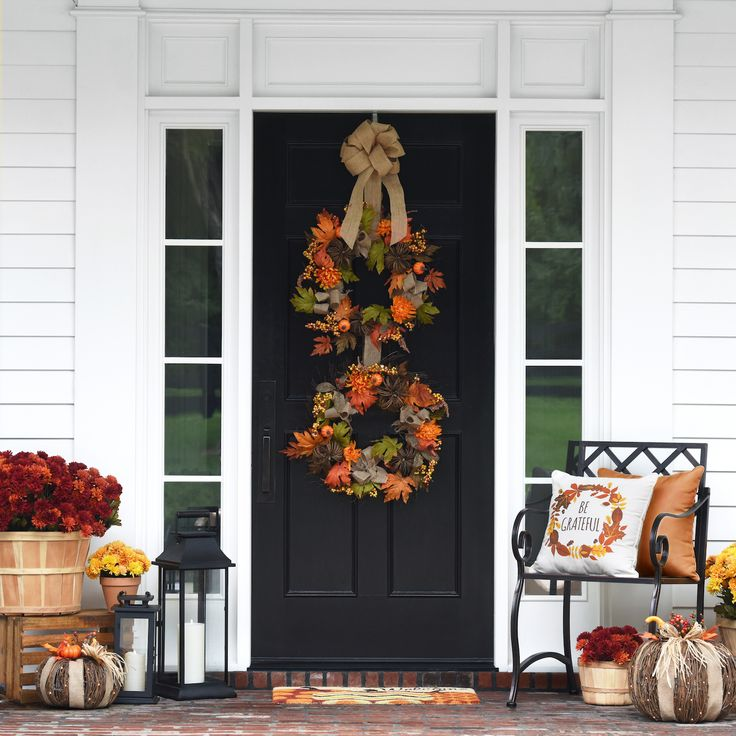 Our Mum and Pumpkin Mix Wreath is sure to make an impression on your neighborhood this fall. This colorful wreath is made of a blend of leaves, mums and pumpkins, accented by a burlap ribbon woven throughout the branches. It will look beautiful on your front door all season!