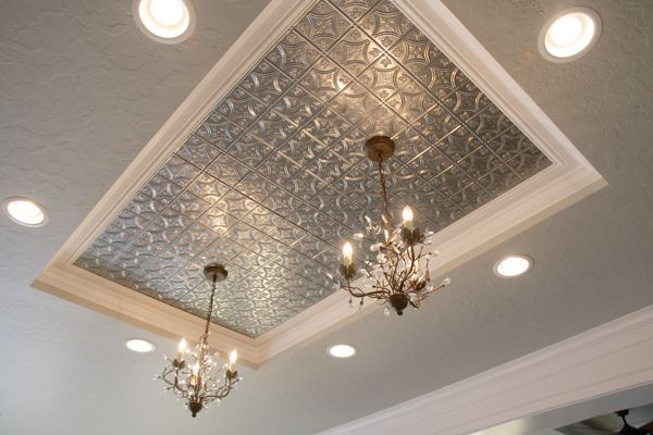 metal tile for ceiling and stove backsplash focal. special ordered from Home Depot for about $35 per 2′x4′ panel.