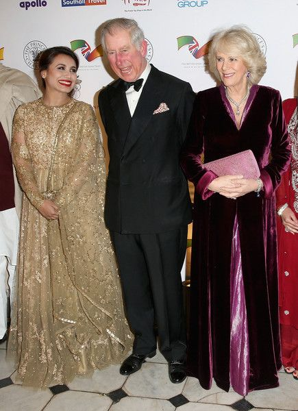 Prince Charles, Prince of Wales and Camilla, Duchess of Cornwall share a joke with Indian actress Rani Mukerji as they attend the British Asian Trust dinner at Banqueting House on February 3, 2015 in London, England.