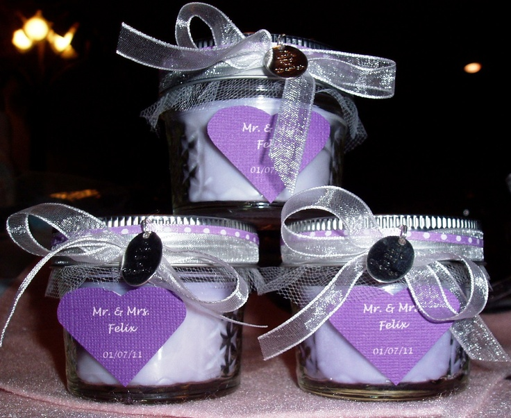 ***homemade scented candles in mason jars as wedding favors.   I would change the decorations and the wax color.